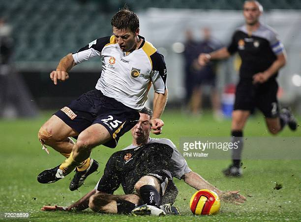 Che Bunce of the Knights cuts down Damian Mori of the Mariners and concedes a penality during the round six ALeague match between the New Zealand...