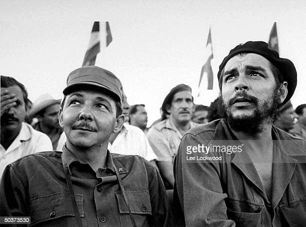 Che Guevara Cuban hero and Raul Castro brother of Fidel sitting on viewing platform during July 26th celebration of the revolution