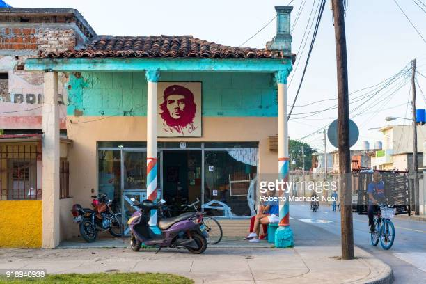Che Guevara photo at the entrance of a commercial establishment located on a city corner Everyday lifestyle in the area