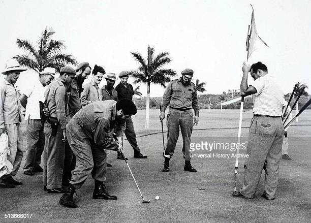 Che Guevara putts as Fidel Castro watches during 1962 golf game at Havana's Colinas de Villarreal golf course following the Cuban missile crisis
