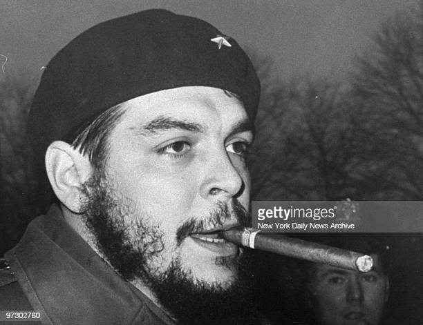 Che Guevera smokes cigar on way out