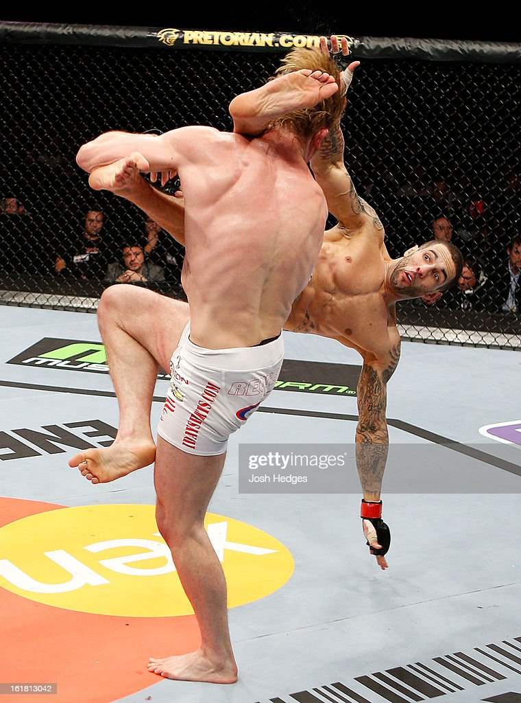 Che Mills kicks Matthew Riddle after a takedown in their welterweight fight during the UFC on Fuel TV event on February 16, 2013 at Wembley Arena in London, England.