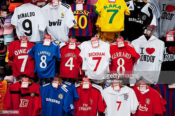 Cheap football shirts for sale at a stall on Oxford Street in Central London. This is a busy shopping area full of all the main high street chain...
