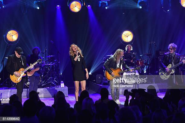 Cheap Trick's Rick Nielsen Jennifer Nettles and Cheap Trick's Robin Zander and Tom Petersson perform during CMT Crossroads Cheap Trick and Jennifer...