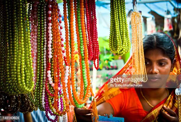 cheaply shopping artificial pearl chain - bangladeshi woman stock photos and pictures