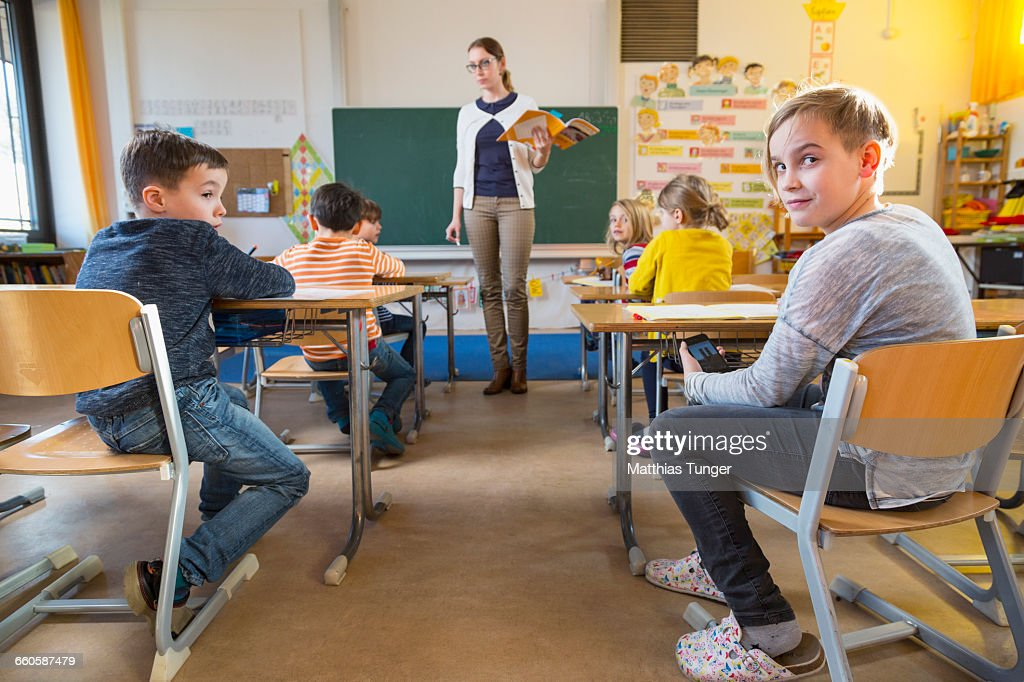 cheating schoolkid in a classroom : Stock Photo