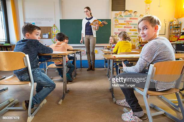 cheating schoolkid in a classroom