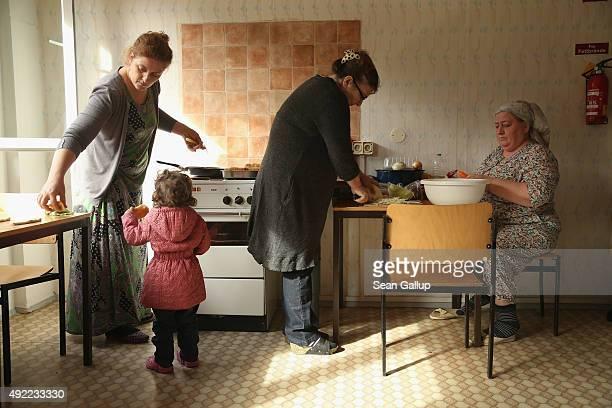 Chechen asylumapplicants Asya Sugaipova Mohza Mukayeva and Khadra Zhukova prepare potatoe piroshki and other foods in the communal kitchen at the...