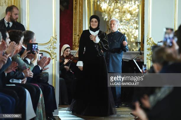 Chechen director of the fashion brand Firdaws Aishat Kadyrova acknowledges the audience at the end of the Firdaws Women's FallWinter 20202021...