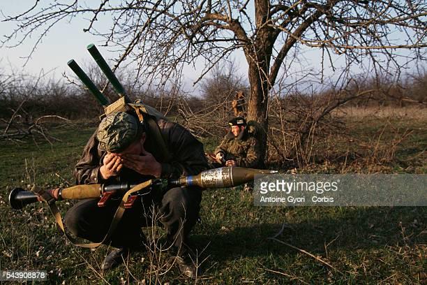 A Chechen fighter bows in prayer during the First Chechen War | Location Goiskoie Chechnya