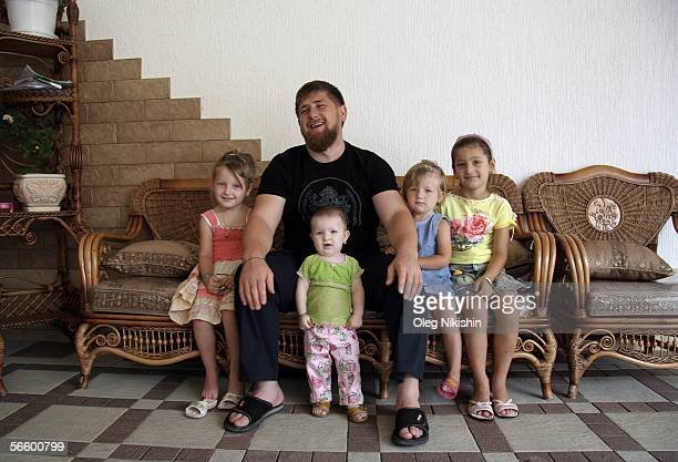 Chechen First Deputy Prime Minister Ramzan Kadyrov poses with his family in Gudermes 2 August 2005 Chechnya Russia Chechen acting premier Ramzan...