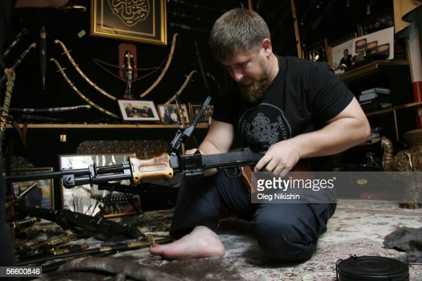 Chechen First Deputy Prime Minister Ramzan Kadyrov shows his extensive collection of weapons in his office in Gudermes 2 August 2005 Chechnya Russia...