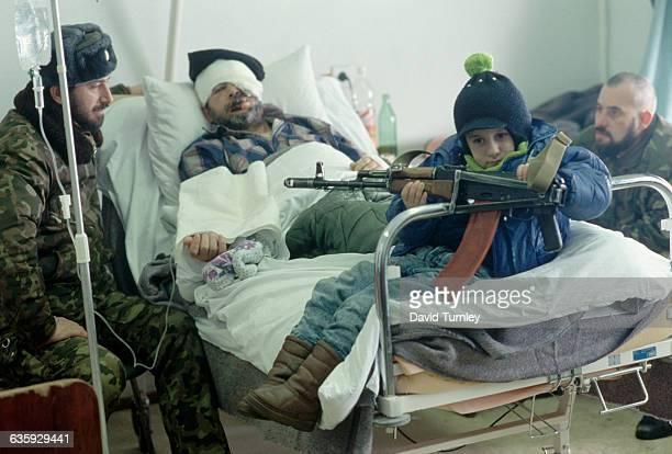 Chechen Guerrillas Visiting Man in Hospital