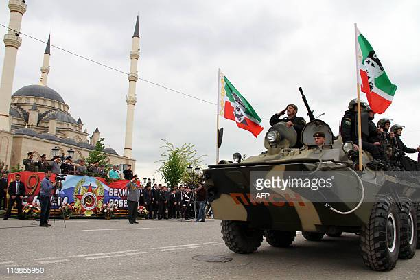 Chechen leader Ramzan Kadyrov watches a parade during celebrations for Victory Day in a park in Grozny on May 9 2011 Russia was due Monday to march...