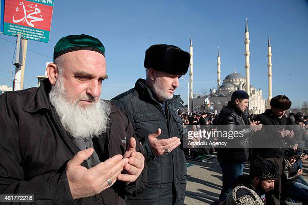 Chechen Muslims gather in downtown regional capital of Grozny during a protest rally on January 19 2015 Thousands of people have marched in the...