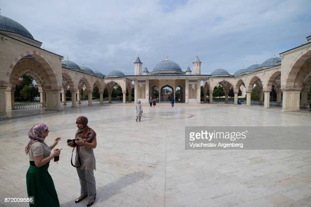 Chechen people at the courtyard of Akhmad Kadyrov Mosque in Grozny