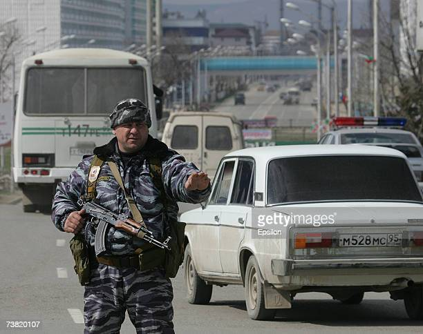 Chechen policeman stands guard during the day of Chechen President Ramzan Kadyrov swearing in ceremony April 5, 2007 Grozny, Chechnya, Russia....