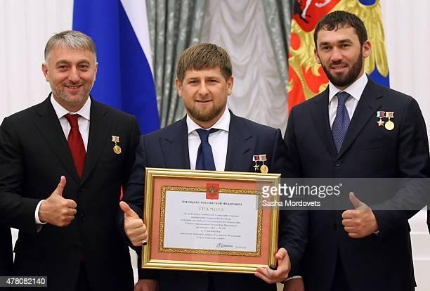 Chechen politician member of the United Russia Party and State Duma Deputy Adam Delimkhanov Chechen President Ramzan Kadyrov and Magomed Daudov Head...