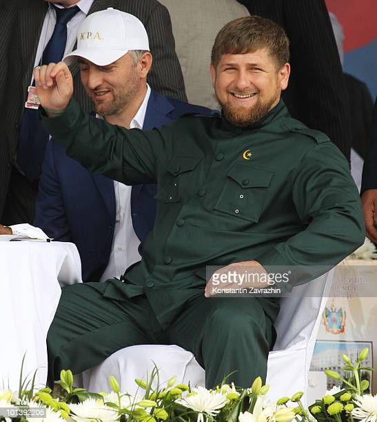Chechen President Ramzan Kadyrov gestures as he and First Deputy Prime Minister Adam Delimkhanov watch a horse race meeting from the stands on June 1...