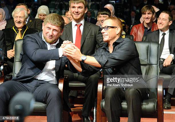 Chechen Republic President Ramzan Kadyrov and actor JeanClaude Van Damme shake hands during the Grozny City commercial complex opening ceremony on...