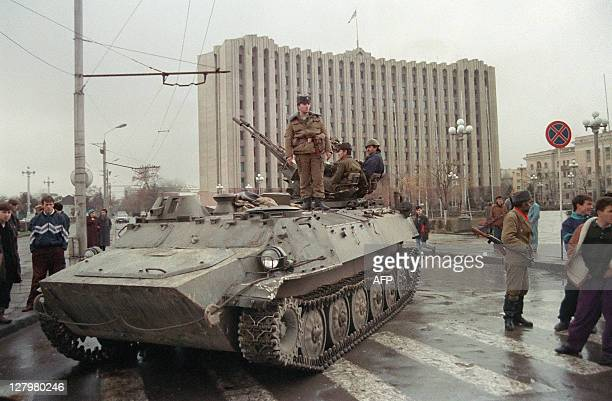 A Chechen separatist soldier stands on an APC guarding the presidential palace on Grozny's central square on November 25 1994 Tension is rising in...