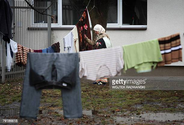 Chechen woman checks her laundry at a refugee camp in the village of Debak near Warsaw 16 January 2008 After the visafree area in Europe was expanded...