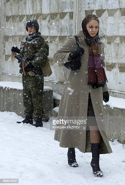 Chechen woman walks past a Russian soldier during a heavy snowfall in Grozny 17 January 2006 An ongoing guerrilla war referred to as a...