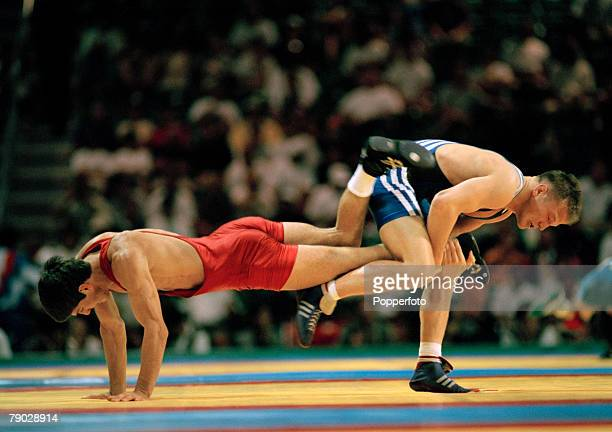 Chechen wrestler Buvaisar Saitiev of Russia pictured in action to win the gold medal with German wrestler Alexander Leipold in their round 2 match of...