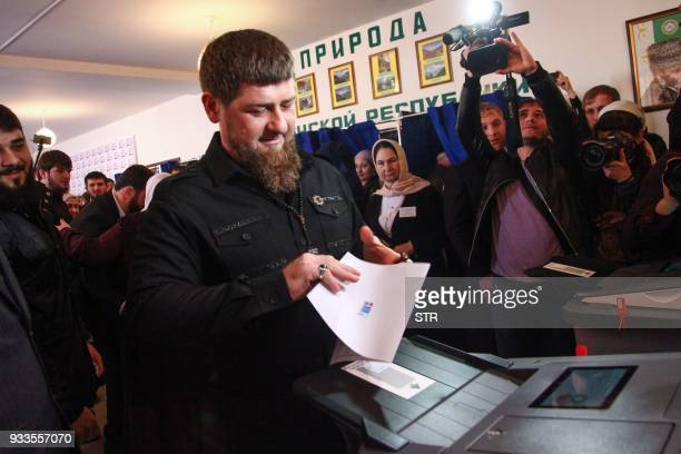 Chechnya's leader Ramzan Kadyrov casts his ballot as he votes during Russia's presidential election at a polling station in the settlement of...
