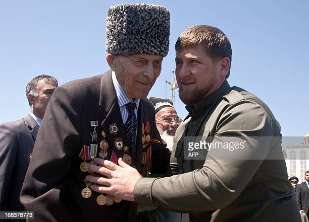 Chechnya's strongman president Ramzan Kadyrov congratulates a World War II veteran during Victory Day celebrations in central Grozny, on May 9, 2013....