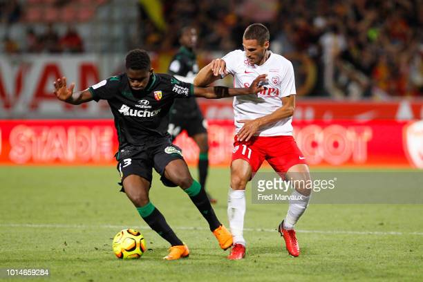 Check Doucoure of Lens and Jeremy Clement of Nancy during the French Ligue 2 match between Nancy and Lens at Stade Marcel Picot on August 10 2018 in...