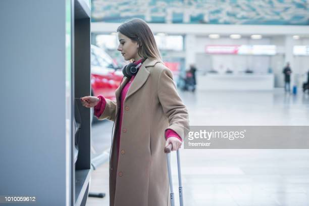check in check out - atm stock pictures, royalty-free photos & images
