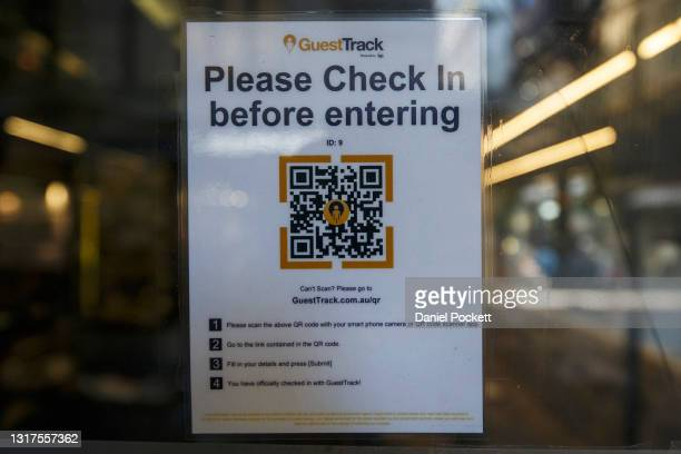 Check in QR code is seen displayed on a restaurant window on May 12, 2021 in Melbourne, Australia. Victoria has recorded no further cases of...