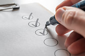 Check off a to-do list with a black pen