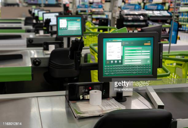 check out terminal in supermarket - no people - cash register stock pictures, royalty-free photos & images