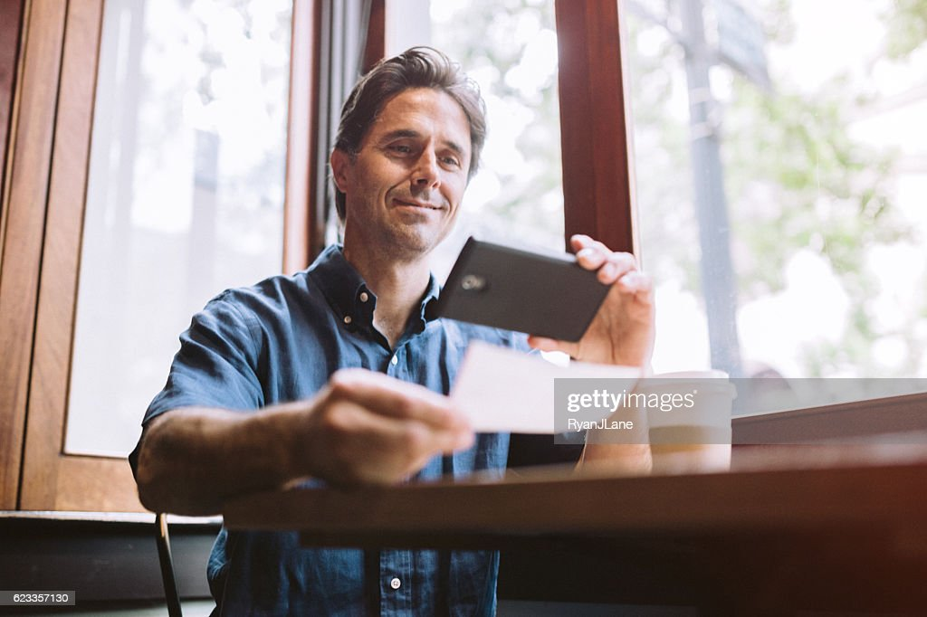 Check Remote Deposit Capture at Cafe : Stock Photo