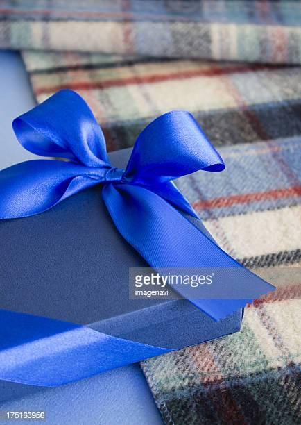 Check stole and a blue gift box