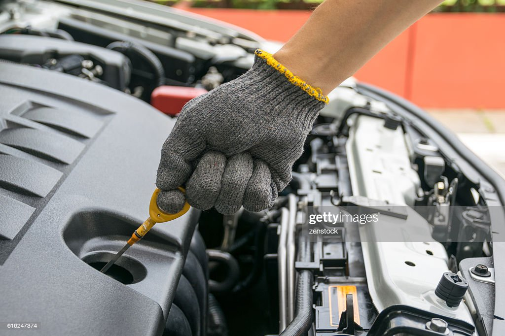 check the oil level in car engine : Stock Photo