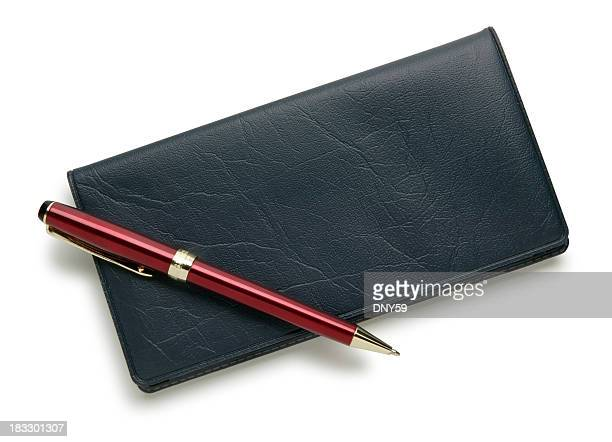 Checkbook and red pen isolated on a white background