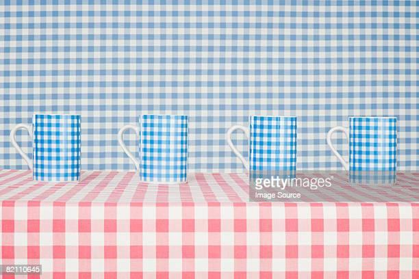 Checker pattern mugs and cloth