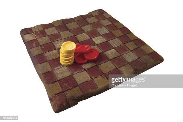 Checkerboard and checker pieces