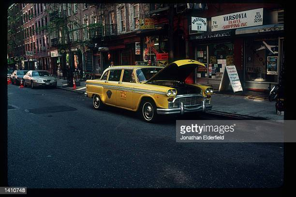 Checkered cab is parked in the Ukrainian section of the East Village June 1, 1998 in New York City. Populated by residents of numerous heritages...