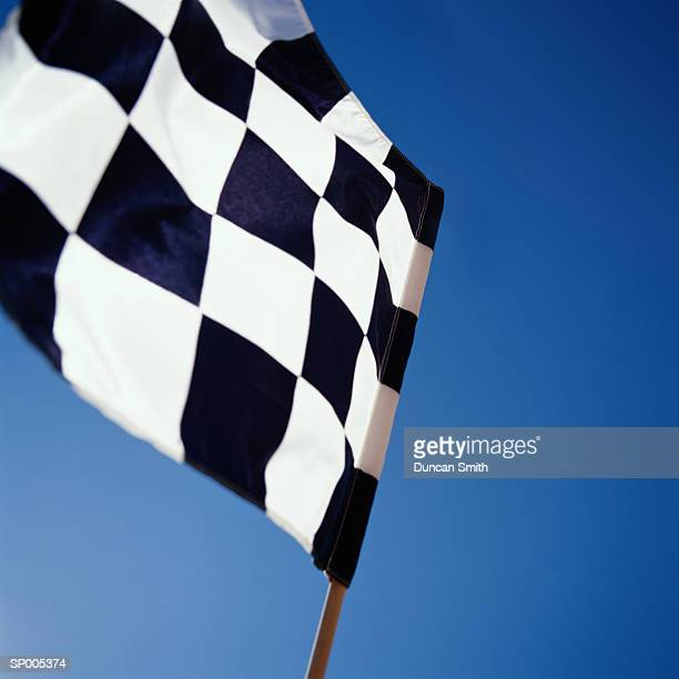 Checkered flag, low angle view, close-up