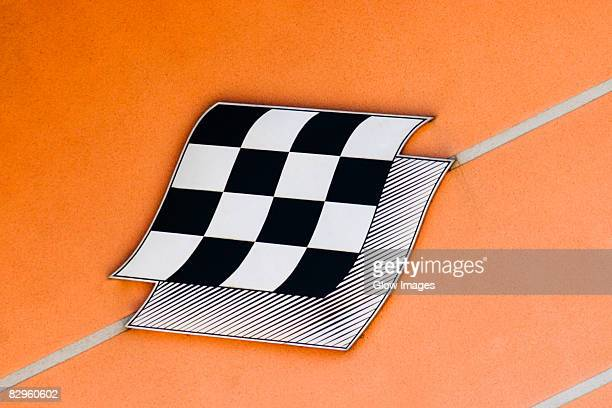Checkered flag on an information board, Le Mans, France