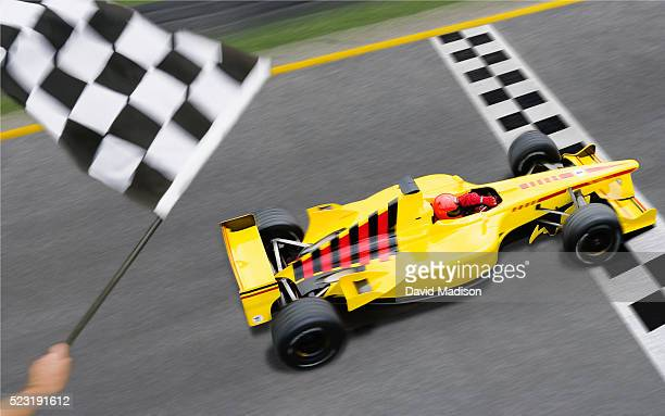Checkered Flag Waving as Racecar Crosses Finish Line