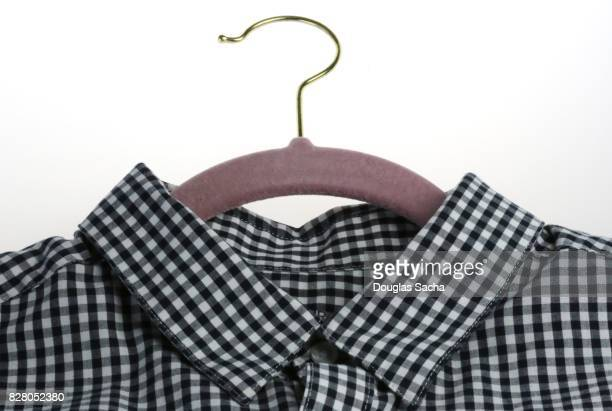 Checkered formal shirt on a closet hanger