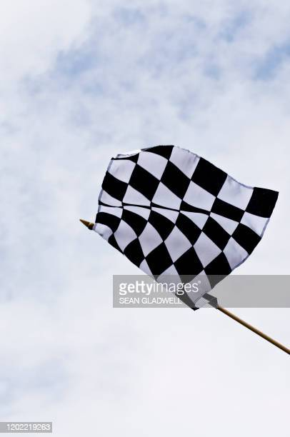 checkered motorsport flag - motorsport stock pictures, royalty-free photos & images
