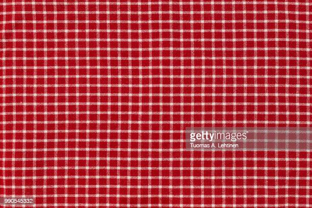 Checkered picnic gingham tablecloth, with red and white squares. Useful as background or backdrop for food editing.