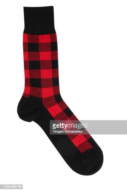 checkered sock on white background - calcetín fotografías e imágenes de stock