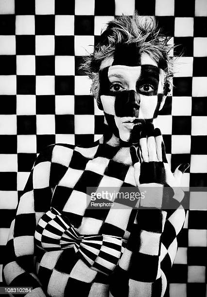 checkered woman - body paint stock pictures, royalty-free photos & images